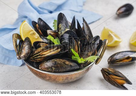Delicious Cooked Seafood Mussels With Lemon And Parsley. Clams In The Shells. Copy Space