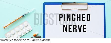 A Clipboard With Paper Lies On A Table Near Drugs And A Syringe. Inscription Pinched Nerve. Medical