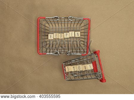 Reopen Store Concept After The Coronavirus Pandemic. Wooden Blocks With Text Reopen Store Top View W