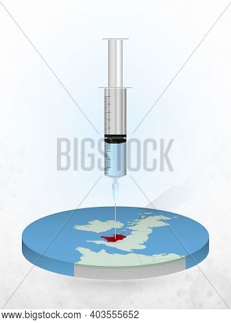 Vaccination Of Wales, Injection Of A Syringe Into A Map Of Wales. Vector Illustration Of A Syringe W