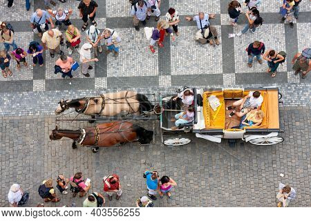 Praha, Czech Republic - Juli 21, 2009: Looking Downward From Tower Old Town Hall. A Carriage With Tw