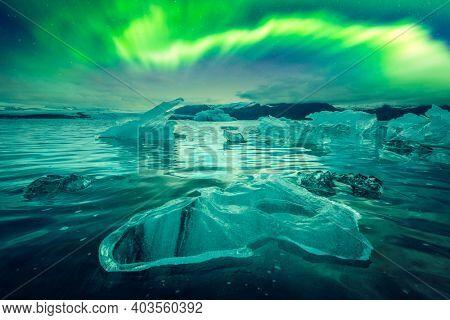 Northern lights over Jokulsarlon Glacial Lagoon, Iceland. Landscape photography. Courtesy of NASA. Photo collage