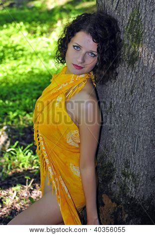 Young Pretty Woman Near The Tree