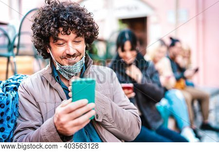 Happy Millenial Guy Smiling Over Open Face Mask After Lockdown Reopening - Hipster Man Watching News