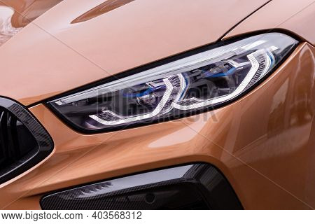 Front Light Of A New Brown Car