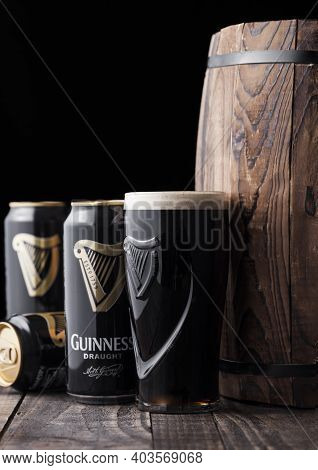 London, Uk - April 27, 2018: Original Glass And Aluminium Cans Of Guinness Draught Stout Beer  Next