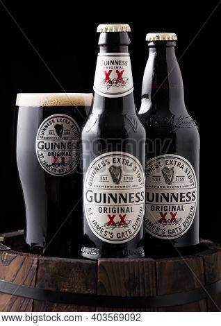 London, Uk - April 27, 2018: Original Glass And Bottles Of Guinness Original Stout Beer On Top Of Ol