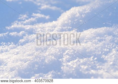 Macro Shot Background Of Fresh White Snow At The Sunset. Snowflakes Texture. Snow Texture Winter Bac