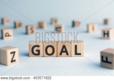 Goal - Word From Wooden Blocks With Letters, An Aim Or Purpose Goal Concept,  White Background