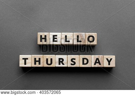 Hello Thursday - Words From Wooden Blocks With Letters, Hello Thursday Concept, Top View Gray Backgr