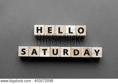 Hello Saturday - Words From Wooden Blocks With Letters, Hello Saturday Concept, Top View Gray Backgr