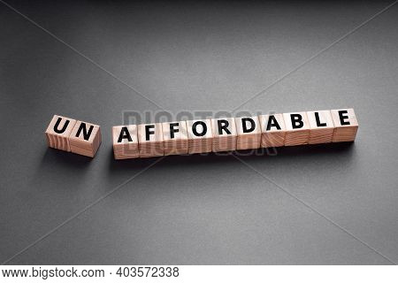 Unaffordable To Un Affordable- Words From Wooden Blocks With Letters, Too Expensive Concept, Top Vie