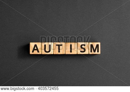 Autism - Word From Wooden Blocks With Letters, Autism Spectrum Disorder (asd) Concept,  Top View On