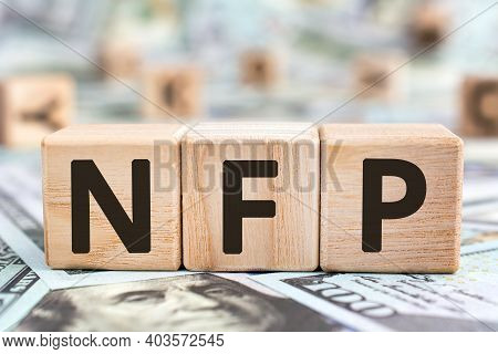 Nfp - Acronym From Wooden Blocks With Letters, Abbreviation Nfp Nonfarm Payrolls Key Economic Indica
