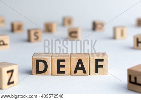 Deaf - Word From Wooden Blocks With Letters, Unable To Hear Deaf Concept,  White Background