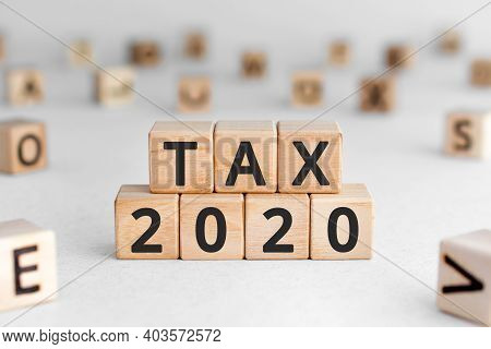 Tax 2020 - Phrase From Wooden Blocks With Letters, Tax Time 2020 Concept, Random Letters Around, Whi