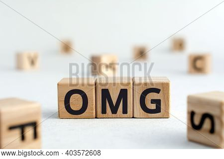 Omg - Acronym From Wooden Blocks With Letters, Omg Abbreviation Oh My God Concept, Random Letters Ar