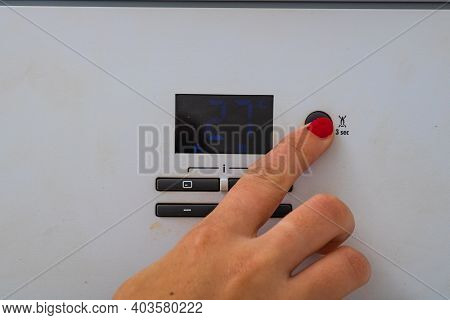 Woman Hand Try To Turn Off And On The Central Heating In The Room. Female Hands On The Central Heati