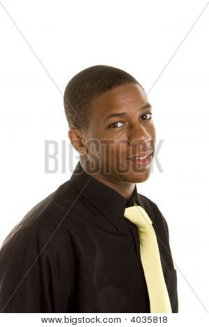 Young Black Man In Black Shirt And Yellow Tie Smiling