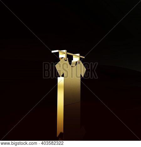 Gold Drying Clothes Icon Isolated On Brown Background. Clean Shirt. Wash Clothes On A Rope With Clot