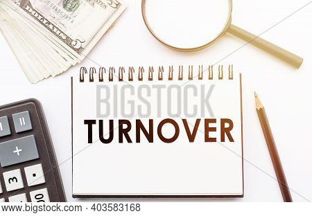 Turnover - Text Written On A Notebook With Office Background.