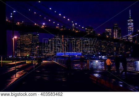 A Landscape View Of The Brooklyn Bridge And The City Of New York In The Background At Night. 1/16/20