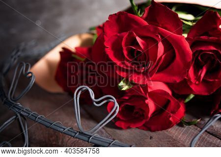 Bouquet Of Red Roses With Hearts On Vintage Wooden Boards. Background For Valentine's Day And Mother