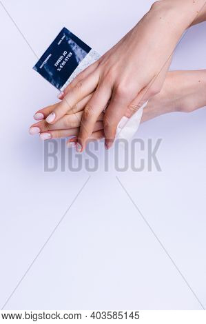 Female Hands Wiping With Antibacterial Wipes On A White Background With A Bottom Blank Space For Adv