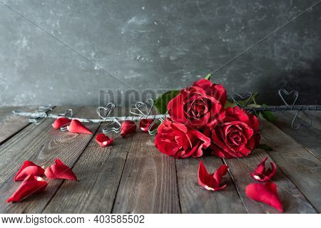 Red Roses With Hearts On Vintage Wooden Boards. Background For Valentine's Day Greetings With Space