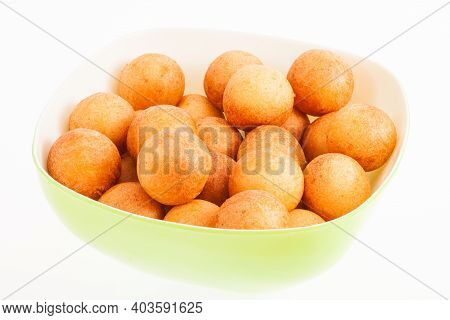 Traditional Colombian Buñuelo - Deep Fried Cheese Bread On White Background.