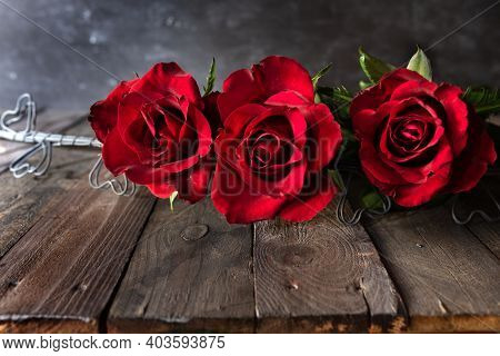 Red Roses On Dark Wooden Boards. Background For Valentine's Day Greeting Card With Space For Text. C