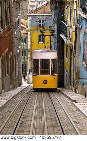 Vertical View Of The Bica Funicular (elevador Da Bica), Lisbon, Portugal. Space For Text.