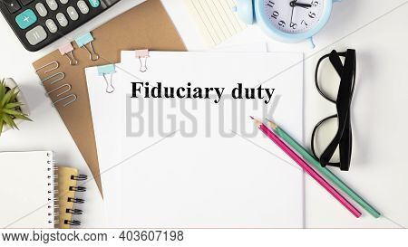 Paper With Fiduciary Duty On A Table