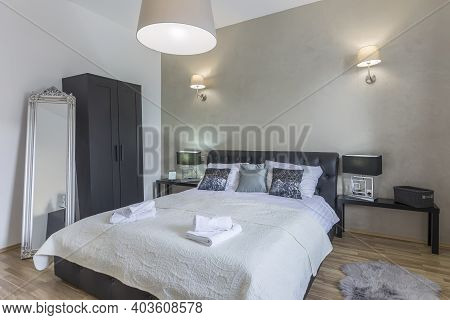 Illuminated Interior Of Modern Luxury Bedroom Accommodation