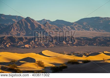 Sand Dunes In Death Valley Near Stovepipe Wells During Sunrise In Death Valley National Park.