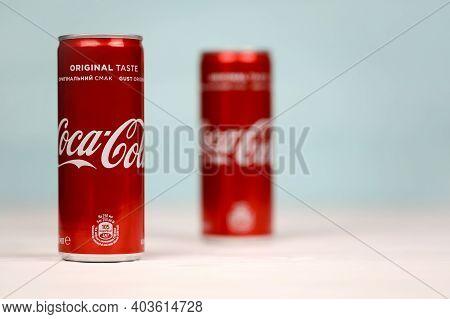 Kharkov, Ukraine - December 8, 2020: Two Coca Cola Aluminium Drink Cans On White Table. Coca-cola Or