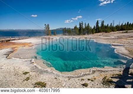The Black Pool At West Thumb Geyser Basin, A Deep Azure Or Turquoise Hot Spring In Yellowstone Natio