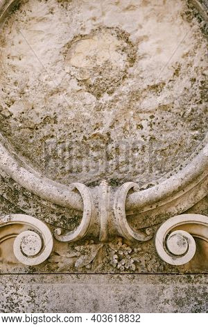 Close-up Of Gray Stone Bas-relief Texture With Gold Rings Of The Bride And Groom.
