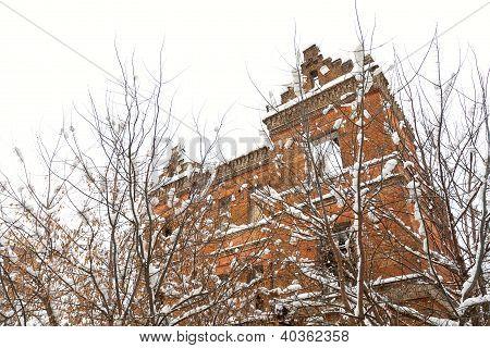 Alone Forsaken House Near Trees Under The Snow In Side View