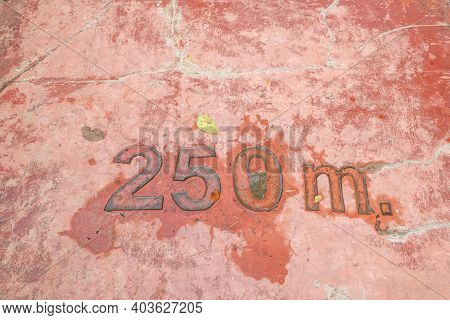 The Numbers On The Dirty Concrete Floor. No. 250 M.