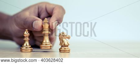 Close-up Hand Chooses King Chess Standing With A Team On Chess Concepts Of Business Team And Leaders