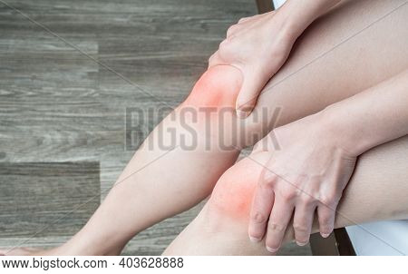 Close Up Of Woman Hands Holding And Massage Her Knee, Suffering From Knee Pain. Knee Pain May Be The