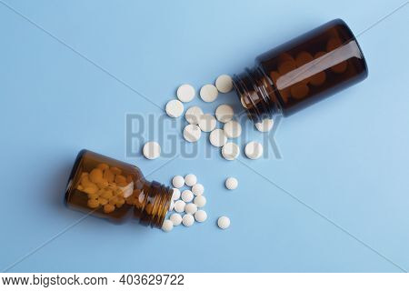 Various Medicine. White Round Pills And Two Pill Bottle