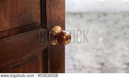 Close Up Copper Door Knob On Wood Door To Protect Virus From Hand Touch For Open Door
