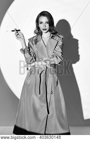 Film Noir Style: Beautiful Elegant Woman Smoking Cigarette. Vintage (retro) Portrait Of Charming You