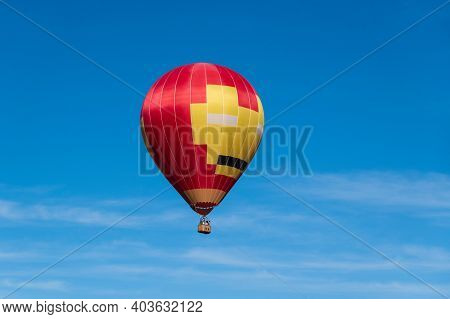 Colorful Hot Air Balloons In Flight. Hot Air Balloon Flying In Light Blue Sky With Copy Space. Large