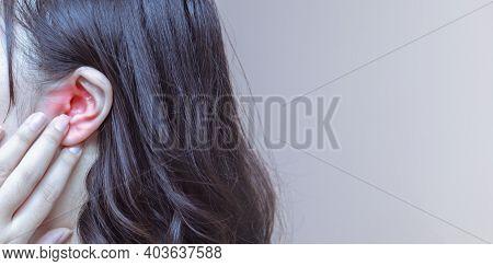 Female Having Ear Pain Touching Her Painful Head Earache