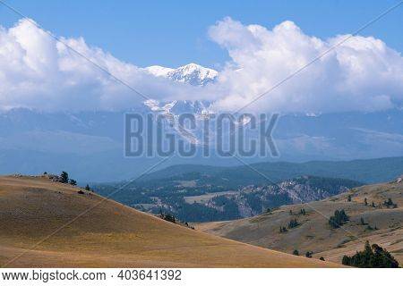 Altai landscape with high mountains cowered by snow. Chuya river valley and North Chuisky Ridge on background. Altai Republic, Siberia, Russia.