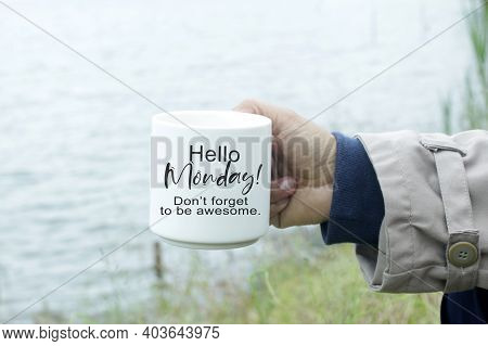 Monday Inspirational Quote - Hello Monday. Do Not Forget To Be Awesome. Person Holding A Cup Of Morn
