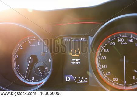 Low Tire Pressure Error Sign. Warning Lights Flash On The Car Dashboard.
